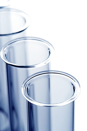Empty laboratory glass test tubes in a row macro viewed close-up from above with blue tint in a science research lab Stock Photo - 10487917