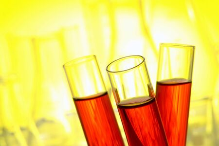Three laboratory glass test tubes filled with red liquid in a lab science experiment Stock fotó