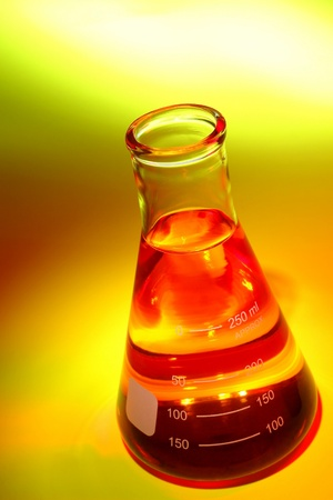erlenmeyer: Laboratory glass Erlenmeyer flask filled with red chemical liquid for a chemistry experiment in a science research lab