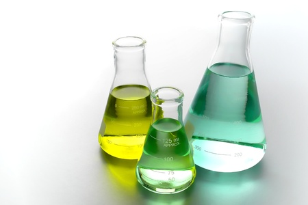 Laboratory glass conical Erlenmeyer flasks filled with chemical liquid for a chemistry experiment in a science research lab Stock Photo