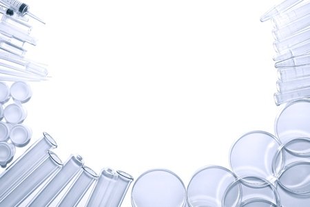 Chemistry laboratory equipment background of glass test tubes and Petri dishes with syringes and assorted experiment glassware in a science research lab
