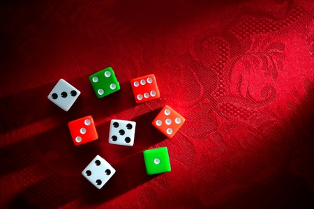 wager: Gambling craps game dice used for shooting and rolling with bet wager on roll over luxurious red damask fabric in a classy casino