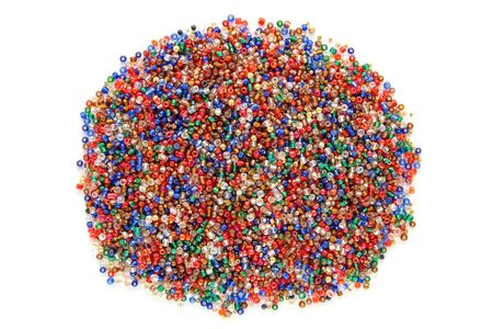 seed beads: Glass and metal colorful tiny seed beads used for costume jewelry and craft weaving decoration in assorted bright colors over white