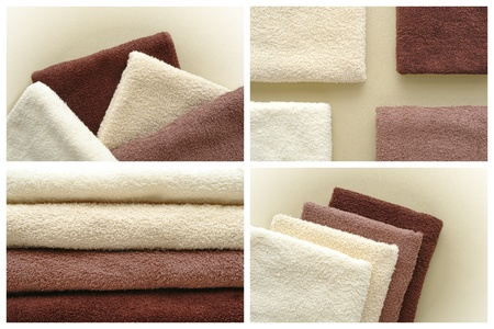Soft and fluffy cotton hotel quality bath towels in light beige to dark brown fashion colors over soft leather surface