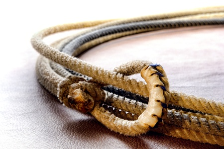 rawhide: American West authentic rodeo cowboy lariat or noose with end loop rawhide speed burner detail  Stock Photo