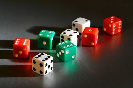 wager: Casino gambling craps game dice used for shooting and rolling with bet wager on roll over reflective surface