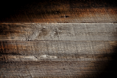Old and distressed antique grey board made of rough sawn barn wood plank with vintage weathered textured grain grunge background