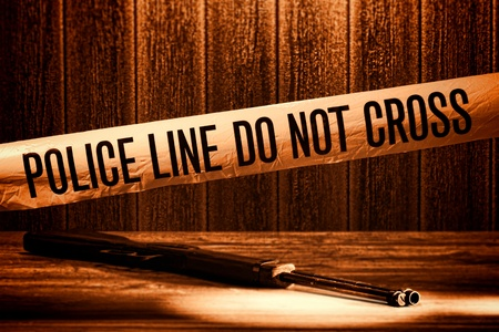 Police line do not cross safety warning tape at forensic murder crime scene with shotgun weapon shooting evidence on floor during a criminal law justice investigation in rough grunge sepia (fictitious representation)