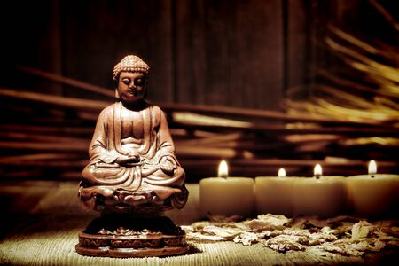 gautama: Statue figurine of meditating Gautama Buddha in sitting lotus position for religious observance and spiritual meditation in a makeshift improvised Buddhist religion temple Stock Photo