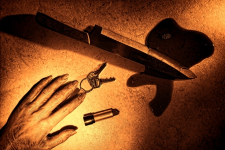 murdering: Gruesome murder crime scene of a dead woman hand and dropped victim set of keys and lipstick tube with bloody kitchen knife weapon in a pool of blood on floor as forensic criminal evidence in rough grunge sepia