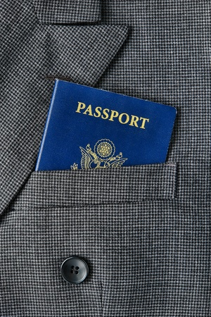 breast pocket: United States of America US citizenship passport book in an American executive business man suit jacket breast pocket for a corporate trip abroad