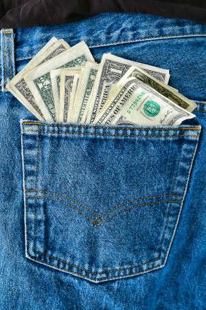 American money used single one US dollar cash bills in worker worn blue jean rear pockets sticking out