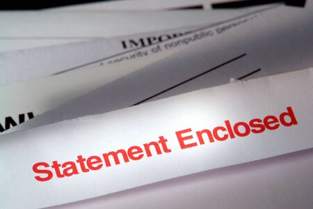 enclosed: Statement enclosed mail envelope on stack of due bills