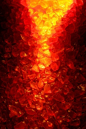 Fiery hot fire lit red and yellow quartz crystal gems background with intense burning lava flow effect