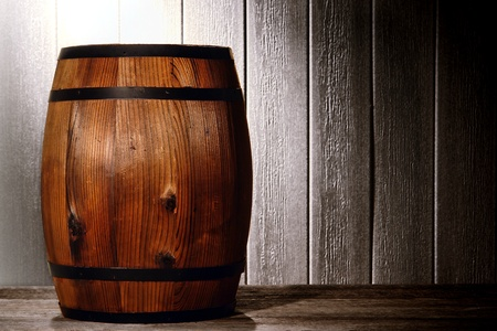 Old wood antique whisky wood barrel or wine keg container in a nostalgic American vintage wooden warehouse