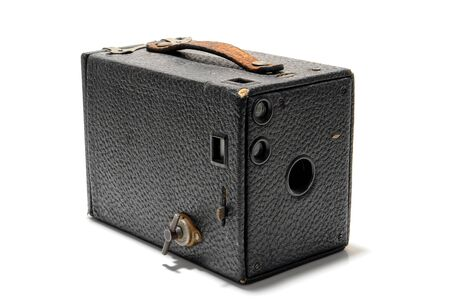 rangefinder: Antique French photo collector Lumiere manual windup roll film camera with old fixed lens and vintage rangefinder covered in black leather with handle over white