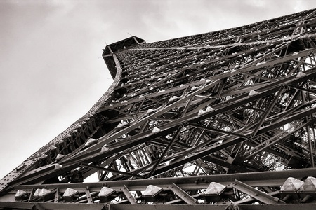 The Eiffel Tower famous tourism landmark in Paris France with pylon metal structure detail view from below in nostalgic vintage sepia Stock Photo - 13265090