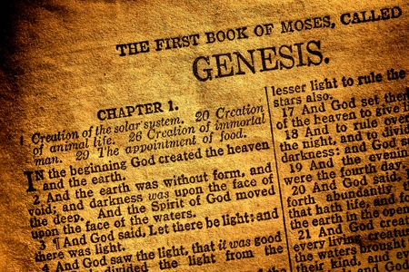 creation: Old antique Holy Bible Christian religion book open to the first page of Moses original chapter of genesis and text about god creation of heaven and hearth in the religious Ancient Testament