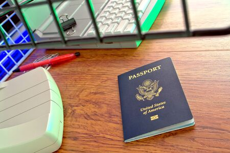 overseas visa: Biometric electronic American proof of citizenship passport ready for inspection at a foreign immigration checkpoint custom counter Stock Photo