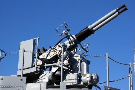 flak: Anti aircraft twin machine guns turret mounted on a US navy boat over blue sky