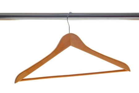 Classic wood clothes hanger hanging on a chrome plated coat closet bar isolated on white Stock Photo