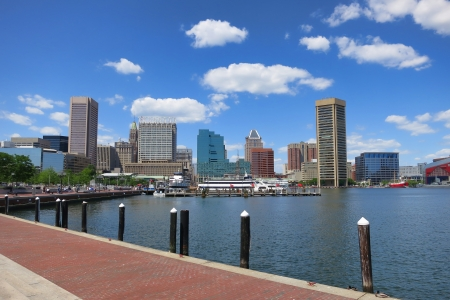 md: Baltimore Maryland inner Harbor scenic area and downtown skyline cityscape with excursion boats in port