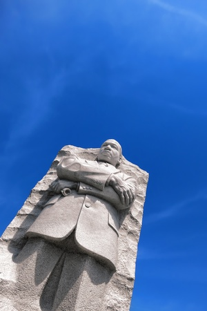 Civil rights hero Dr Martin Luther King Jr Memorial granite statue in West Potomac Park near the landmark National Mall in the United States capital of Washington DC over blue sky Stock Photo - 13659418