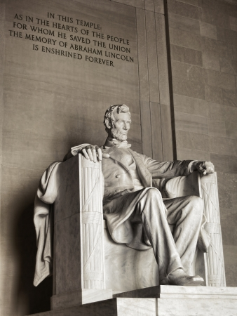 United States president Abraham Lincoln National Memorial landmark marble sculpture and commemorative historic text engraved in monument wall in the USA federal capital of Washington DC photo