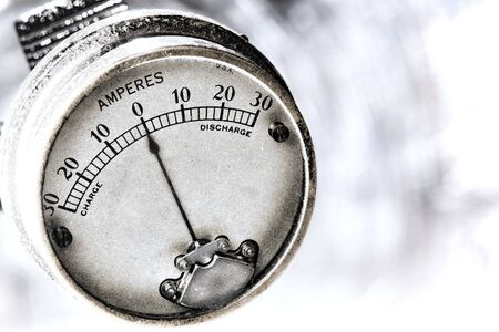 ampere: Vintage amperes electric charge current electrical measuring instrument gauge Stock Photo