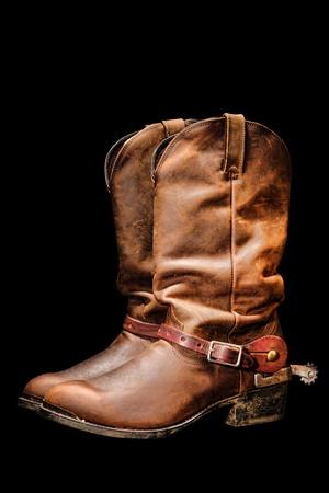 ranching: American West par de vaquero de rodeo de los tradicionales de cuero de estilo occidental Roper botas de montar con espuelas de cr�a de aut�nticos aislados sobre fondo negro puro