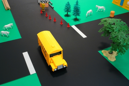 Miniature toy American yellow school bus in driver safety education photo