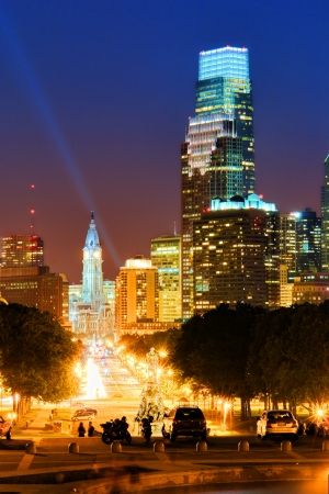 Downtown Philadelphia Center City scenic cityscape skyline in Pennsylvania with city hall and Comcast building skyscraper at the end of Benjamin Franklin Parkway from the Art Museum steps at night