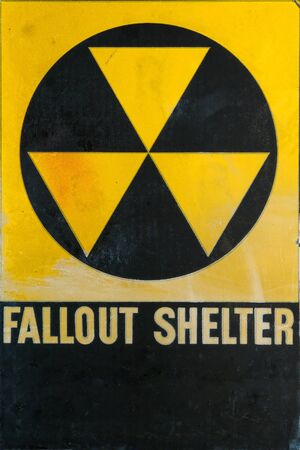 Vintage grunge Cold War era civil defense fallout shelter refuge sign for emergency and nuclear attack protection  photo