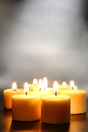 Votive candles burning with a soft glow flame Stock Photo