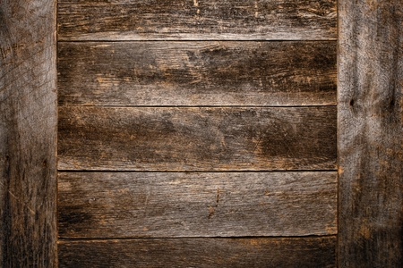 Old and antique wood plank board grunge background made of aged and weathered vintage barn wood with worn grain and texture