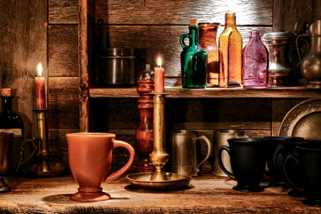 inn: Antique Ceramic beverage mug and assorted drinking cups with old glass bottles and authentic pub drink serving tableware