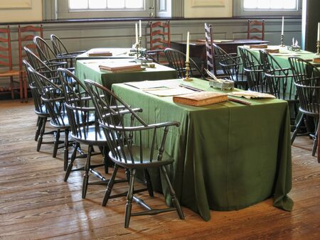 Signature tables of the United States Declaration of Independence by the American congress in the historic Assembly room at Independence Hall in Philadelphia Pennsylvania as home of the July fourth 1776 birthplace of the USA Stock Photo - 17392883
