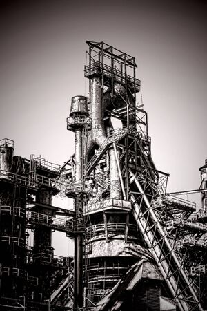 antique factory: Old antique industrial blast iron metallurgical steel plant smelting furnace abandoned factory structure Stock Photo