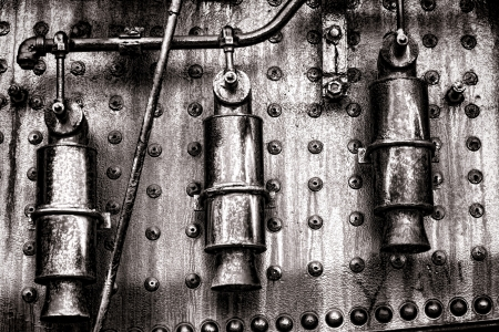 Old locomotive steam engine grunge detail with three pressure relief valves Stock Photo - 17481253