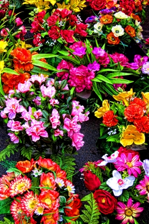 hues: Bright and beautiful cut fresh flowers with colorful hues on display for sale at a traditional outdoor farmer market