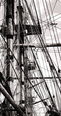 cordage: Mast and spars with antique ropes cordage rigging apparatus on an old sailing ship