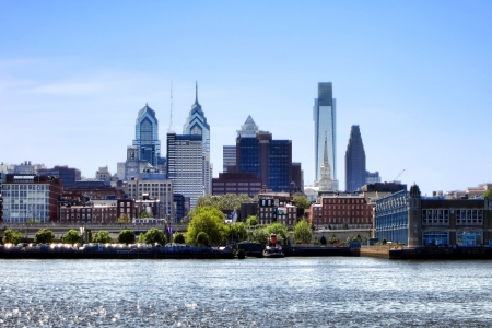 landing: Downtown Philadelphia in Pennsylvania Center City scenic cityscape with skyline of modern skyscrapers and office buildings above Penn's Landing on the Delaware River