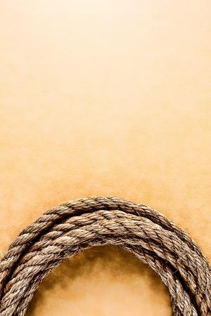 ranching: American West rodeo ganader�a lazo cuerda en el fondo grunge superficie de cuero suave
