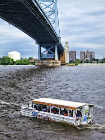 amphibious: PHILADELPHIA, PA, USA, July - Amphibious sightseeing tourist transportation vehicle Ride The Ducks sailing again after earlier tragedy on the Delaware River under the Ben Franklin Bridge on July 25 in Philadelphia Pennsylvania Editorial