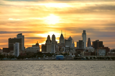 Downtown Center City Philadelphia scenic skyline with skyscraper buildings and Old City historic landmarks on the Delaware River at Sunset Stock Photo