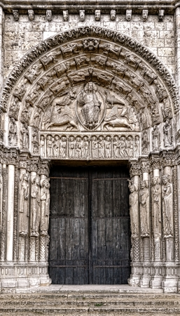 chartres: Cathedral of Our Lady of Chartres West facade central portal with tympanum in a representation of the End of Time with lintel showing the Twelve Apostles and archivolts showing the 24 Elders of the Apocalypse in flamboyant gothic architecture style Stock Photo