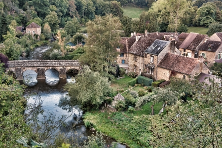 quaint: Quaint French rural village of St Ceneri le Gerei in the Normandy and Maine National Park area of France with old stone bridge over the Sarthe River and antique houses