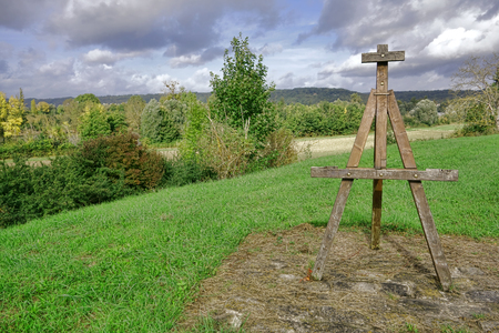 homage: Painter wood easel roadside commemorative monument as homage to French impressionism painting over a scenic Seine river valley landscape in the bucolic Normandy region of France