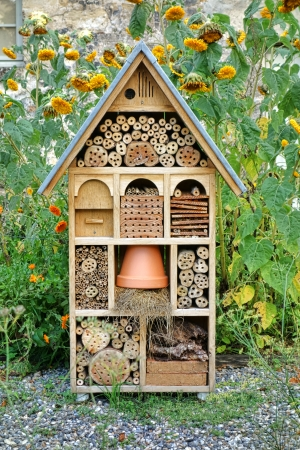 Craftsman built insect hotel decorative wood house with compartments and natural components refuge made to protect and promote ladybugs and butterflies hibernation as useful garden pests