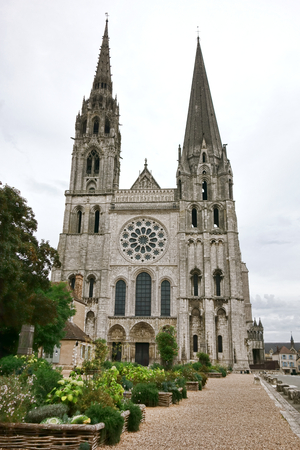 esplanade: Cathedral of Our Lady of Chartres gothic style church west facade and steeples with front garden esplanade decorative planters in the Beauce region of France
